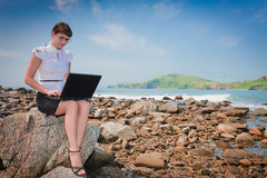 Funny girl on the beach sitting Royalty Free Stock Photo