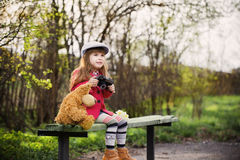 Funny girl on bench in park Royalty Free Stock Image