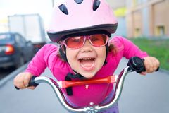 Funny girl and bicycle stock photography