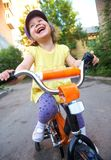 Funny girl and bicycle Royalty Free Stock Image