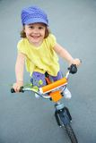 Funny girl on bicycle Royalty Free Stock Photography