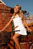 Funny girl with bicycle Royalty Free Stock Images