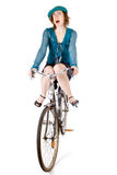 Funny girl on bicycle Stock Photography