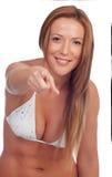 Funny girl in bikini indicating at camera Royalty Free Stock Image
