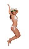 Funny girl in bikini jumping Royalty Free Stock Images