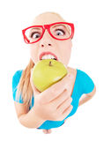 Funny girl biting an apple Royalty Free Stock Images