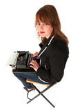 Funny girl with black typewriter Stock Image