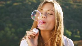 Funny Girl Blowing Soap-Bubbles stock video footage