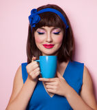 Funny girl with blue cup Royalty Free Stock Photo