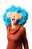 Funny girl with blue wig and big white eyeglasses Stock Photo