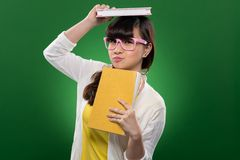 Funny girl with books Royalty Free Stock Images