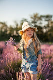 Funny girl with bouquet of lavender. Stock Photos