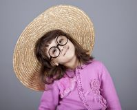 Funny girl in cap and glasses. Royalty Free Stock Image