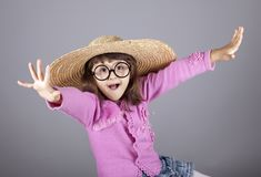 Funny girl in cap and glasses. Royalty Free Stock Photo