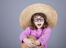 Funny girl in cap and glasses keeping pumpkin. Stock Image