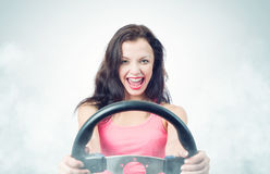 Funny girl with car wheel and smoke Royalty Free Stock Image