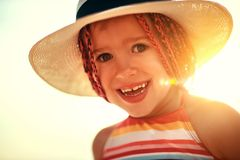 Funny girl child in hat on beach royalty free stock photo