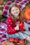 Happy child girl with pumpkin outdoors in halloween park stock images