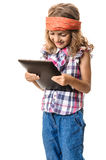 Funny girl child multimedia tablet PC Royalty Free Stock Photo