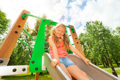 Funny girl on children chute ready to slide Stock Photography