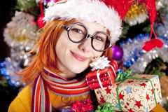 Funny girl in christmas cap with gift boxes Royalty Free Stock Photos