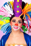Funny girl clown with a big colorful wig Royalty Free Stock Image