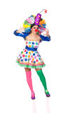 Funny girl clown with a big colorful wig Royalty Free Stock Photography