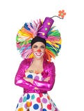 Funny girl clown with a big colorful wig Stock Photo