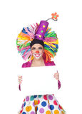 Funny girl clown with a blank advertising for text Royalty Free Stock Image