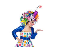 Funny girl clown looking something over her hand. Isolated on white background royalty free stock photos