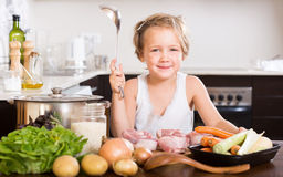 Funny  girl cooking food Royalty Free Stock Photography