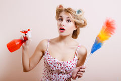 Funny girl in curlers with red spray and rainbow Stock Image