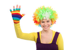 Funny girl in curly wig shows hand in glove Stock Photo