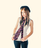 Funny girl in derby hat and colorful tie. Toned image Royalty Free Stock Photo