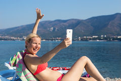 Funny girl doing selfieon  beach Royalty Free Stock Images