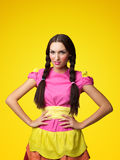 Funny girl in doll costume look serious Stock Image