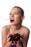 Funny girl eat ripe cherry isolated Stock Photos
