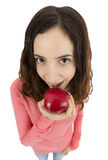 Funny girl eating an apple Stock Images