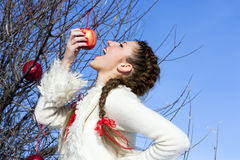 Funny girl eating apple outdoor Stock Photo