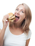 Funny girl eating burger isolated on white background Stock Photo
