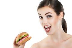 Funny girl eating hamburger Stock Photo