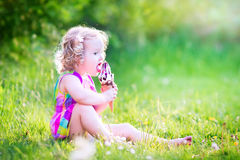 Funny girl eating ice cream in the garden Royalty Free Stock Photo
