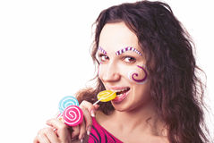 Girl eating a lollipop Stock Image