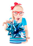 Funny girl excited by getting a present Royalty Free Stock Image