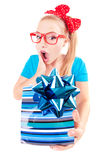 Funny girl excited by getting a present Stock Photography