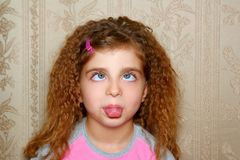 Funny girl face expression cross-eyed squint Royalty Free Stock Photo