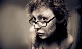 Funny girl with facial mask. Stock Photography
