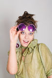 Funny girl in fancy glasses Stock Image