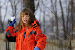 Funny Girl Fighting With Snowballs Royalty Free Stock Photo