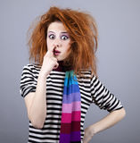 Funny girl with finger in nose. Royalty Free Stock Images